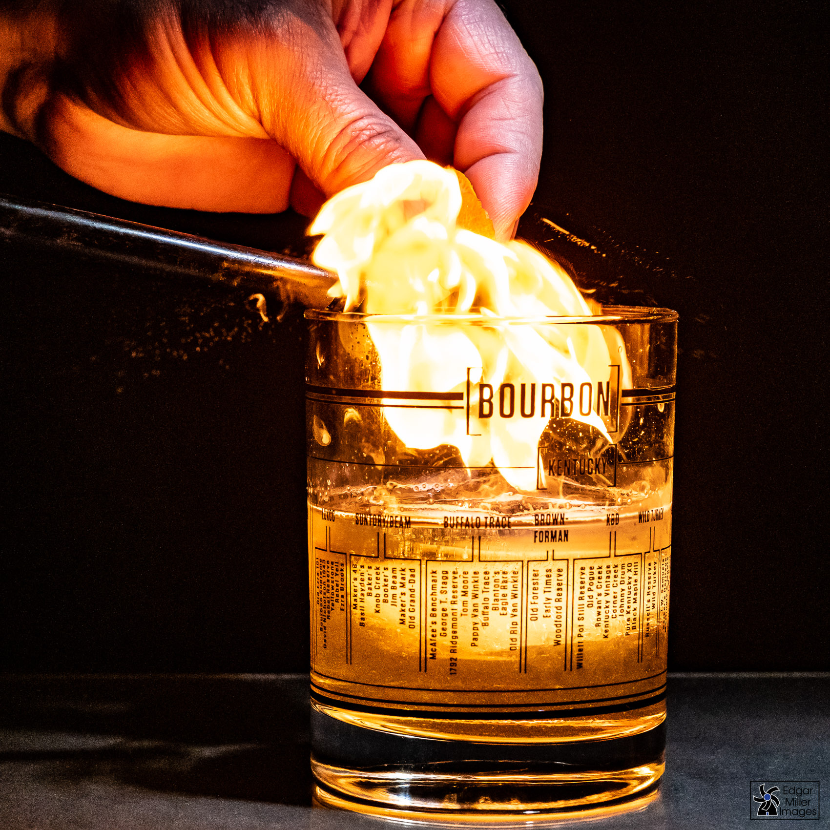 Flaming an Orange Peel over Whiskey